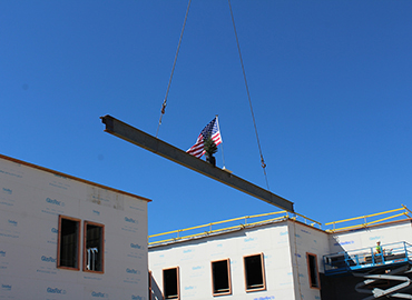 Beaming being lifted into place at the new Middle School.