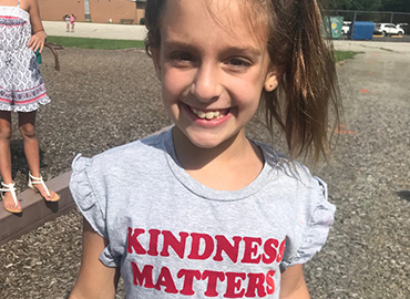 Photo of student wearing a Kindness Matters tshirt.