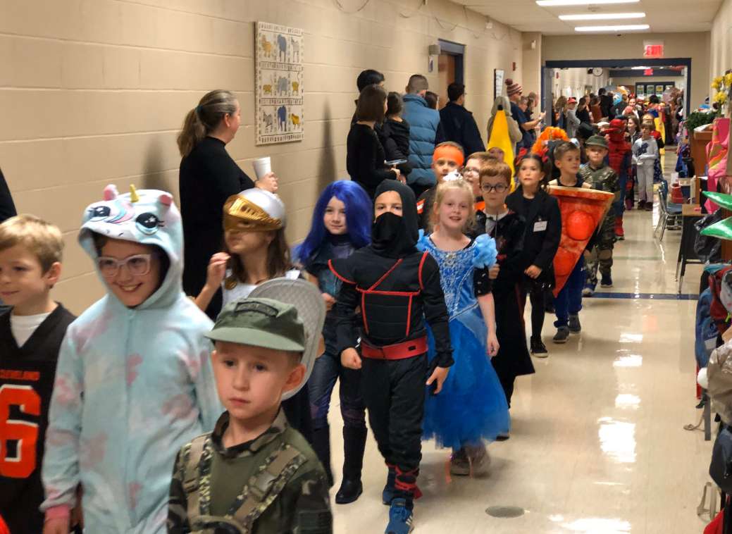 Ellsworth Hill students show their costumes to visiting parents and families.