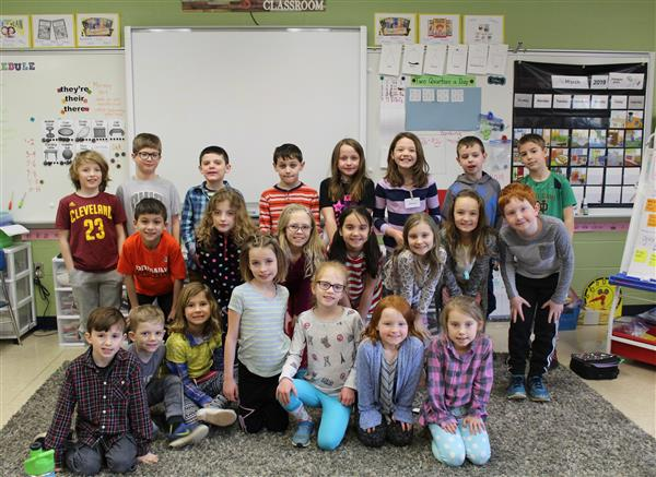 Second grade class posed for a group photo on mismatch day.
